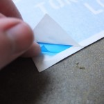 Detail view of the layers. The blue film is the actual stencil which sticks lightly, like a sticky note.